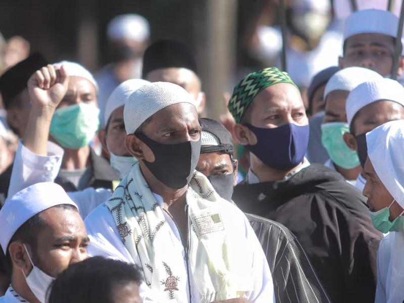 Meski aksi berlangsung ditengah Pandemi Covid 19 , tampak para peserta aksi disiplin menggunakan masker dan menjaga jarak.