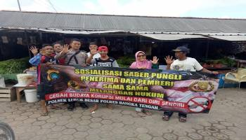 Kampanyekan Pelayanan Bebas Pungli, Polsek Lubuk Besar Gelar Sosialisasi ke Pasar Lubuk Pabrik
