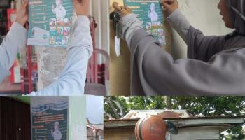 Mahasiswa KKN UBB Kelurahan Parit Padang Bagi-Bagi Poster
