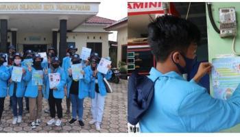 Tim KKN UBB Kelurahan Selindung Lama Bagikan Poster Protokol Kesehatan